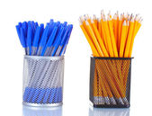 Lead pencils and pens in metal cups isolated on white — Stock Photo
