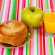 Classical breakfast. Orange juice and bun - Stock Photo