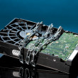 Stock Photo: Hard disk drive on chain on dark blue background