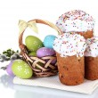 Beautiful Easter cakes, colorful eggs in basket and flowers isolated on white - Foto Stock