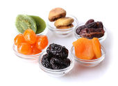 Dried fruits in bowls isolated on white — Stock Photo