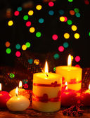 Beautiful candles on wooden table on bright background — Foto Stock