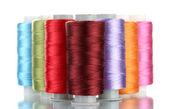 Bright bobbin thread isolated on white — Stock Photo