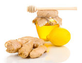Ginger with lemon and honey isolated on white — Stock Photo
