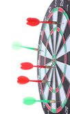 Dart board with darts isolated on white — Stock Photo
