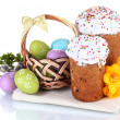 Royalty-Free Stock Photo: Beautiful Easter cakes, colorful eggs in basket and flowers isolated on white