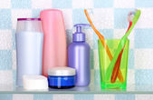 Shelf with cosmetics and toiletries in bathroom — Стоковое фото