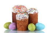 Beautiful Easter cakes and colorful eggs isolated on white — Stock Photo