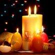 Beautiful candle and decor on wooden table on bright background - Foto Stock