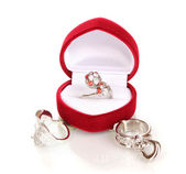 Silver ring with red, pink and clear crystals in red velvet box and some silver rings isolated on white — Stock Photo