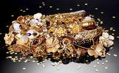 Beautiful golden jewelry on grey background — Stock Photo