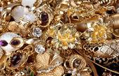 Beautiful golden jewelry close up — Stock Photo