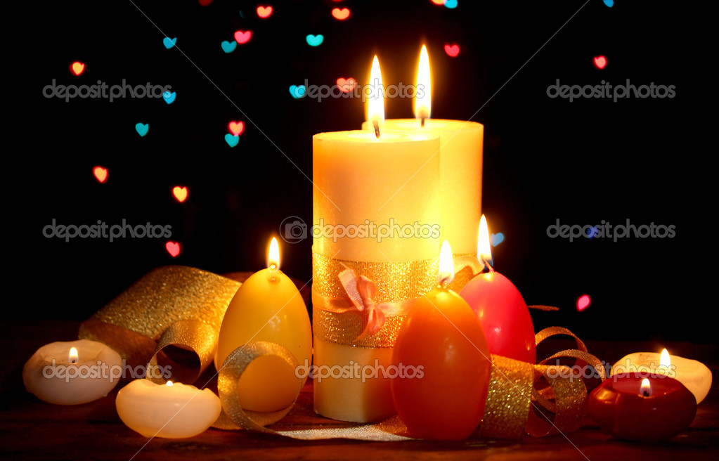 Beautiful candle and decor on wooden table on bright background — Stock Photo #10094356