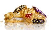 Elegant and fashion golden bracelets isolated on white background — Stock Photo