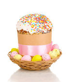 Beautiful Easter cake in basket with eggs isolated on white — Photo