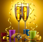 Glasses of champagne, candles, gifts and streamer on yellow background — Stock Photo
