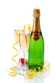 Glasses and bottle of champagne, gifts and serpentine isolated on a white — Stock Photo
