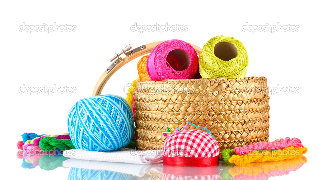 Bright threads for needlework and fabric in a wicker basket — Stock Photo #10121142