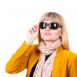 Beautiful young woman in bright jacket with sunglasses isolated on white — Stock Photo #10138224