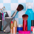 Shelf with cosmetics and toiletries in bathroom — Stock Photo #10139651