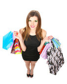 Beautiful young woman with shopping bags isolated on white — Stock Photo