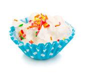 Creamy cupcake isolated on white — Stock Photo