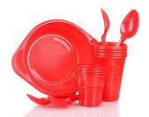 Talheres de plástico vermelho brilhante isolado no branco — Foto Stock