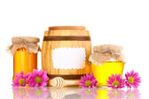 Sweet honey in jars and barrel with drizzler isolated on white — Stock Photo