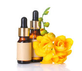 Bottles with essence oil and flower isolated on white — Stock Photo