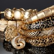 Beautiful golden bracelets and rings on grey background — 图库照片