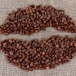 Stock Photo: Coffee beans on a sack background