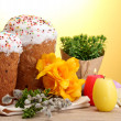 Beautiful Easter cakes, colorful eggs and candles on wooden table on yellow background — Stock Photo #10197715