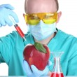 Scientist injecting GMO into the apple — Stock Photo