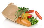 Paper bag with food isolated on white — Stock Photo
