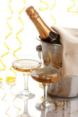 Champagne bottle in bucket with ice and glasses of champagne, isolated on white — Stock Photo