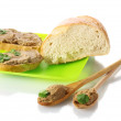 Fresh pate on bread on green plate isolated on white — Stock Photo