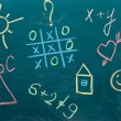Stock Photo: The drawings and inscriptions in colorful chalk on the blackboard