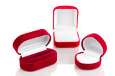 Red jewelry boxes isolated on white — Stock Photo