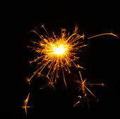 Beautiful sparkler on black background — Stock Photo
