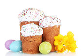 Beautiful Easter cakes, colorful eggs and flowers isolated on white — Stock Photo