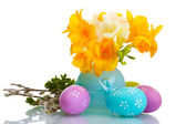 Beautiful yellow freesias in vase, Easter eggs and pussy-willow twigs isolated on white — Stock Photo