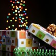 Open gift box with bokeh background on black - Stock Photo