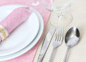 Table setting with fork, spoon, knife, plates, and napkin — Stock Photo