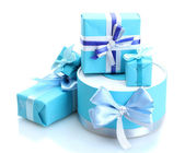 Blue gifts with bows isolated on white — Stock Photo
