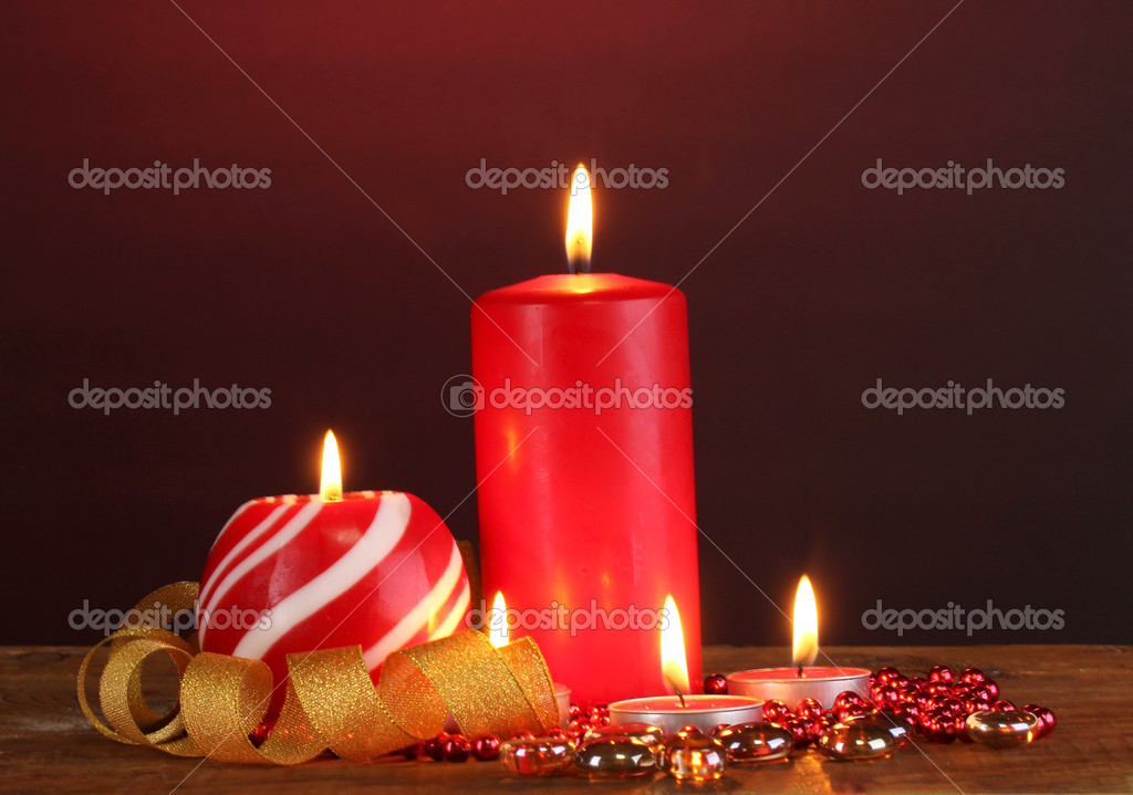 Wonderful candles on wooden table on dark background  Zdjcie stockowe #10259212