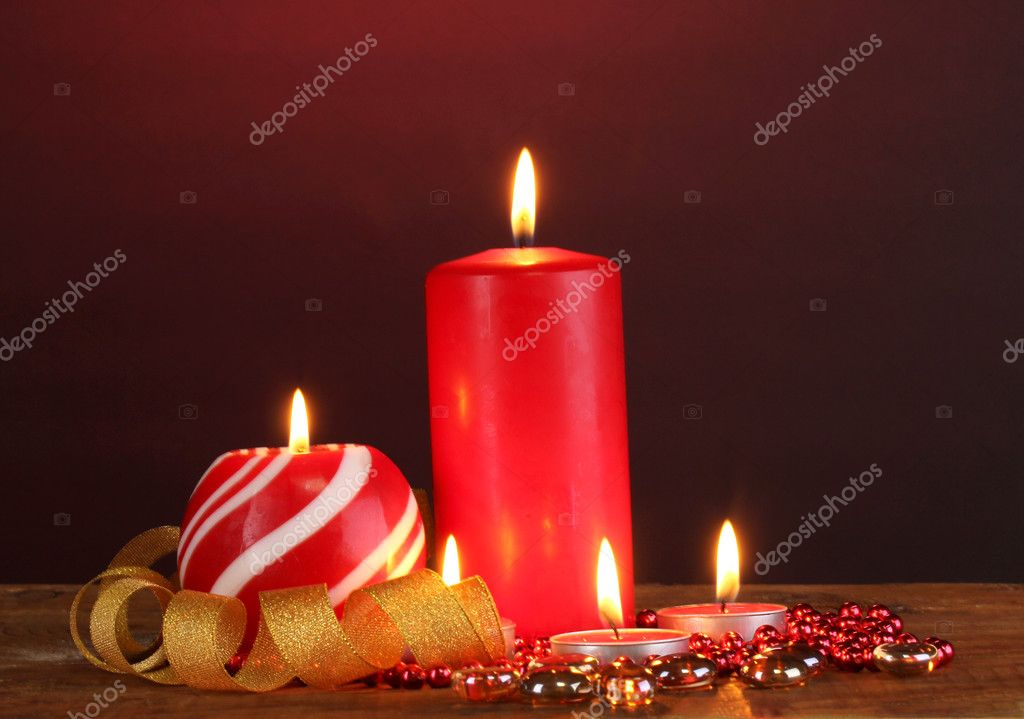 Wonderful candles on wooden table on dark background  Stockfoto #10259212