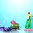 Постер, плакат: Washing dishes Cleaning products on bright blue background