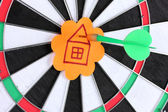 Darts with stickers depicting the life values close-up on white background — Stockfoto