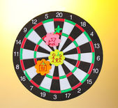 Darts with stickers depicting the life values on colorful background. The darts hit the target — Stock Photo