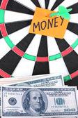 Darts with a sticker symbolizing money close-up — Stock Photo